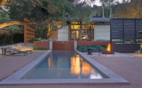 10 Modern Fireplaces and Fire Pits to Inspire Outdoor Living the courtyard in the center of the compound opens with a lovely lap pool 1 480x300
