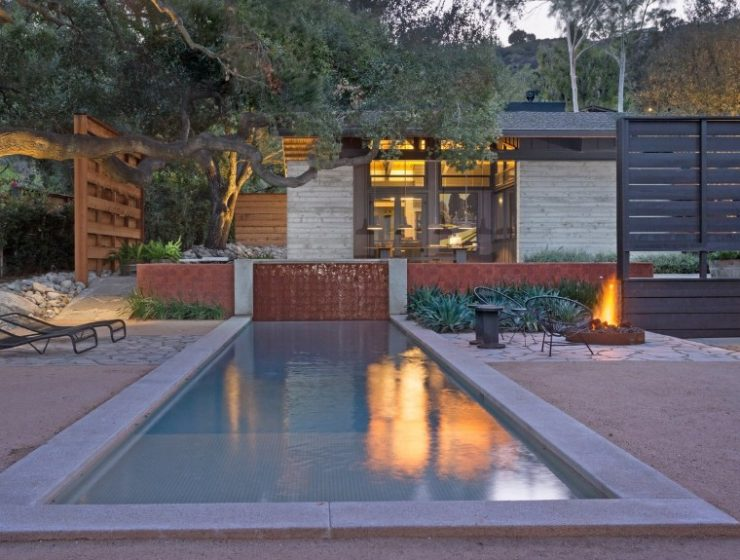 10 Modern Fireplaces and Fire Pits to Inspire Outdoor Living the courtyard in the center of the compound opens with a lovely lap pool 1 740x560