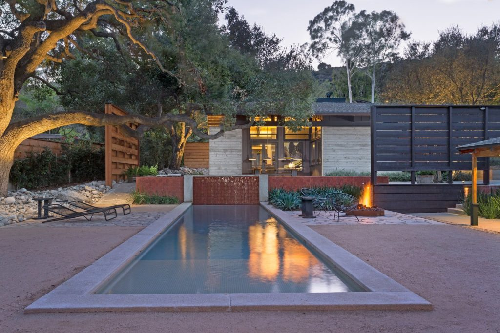10 Modern Fireplaces and Fire Pits to Inspire Outdoor Living the courtyard in the center of the compound opens with a lovely lap pool 1024x683